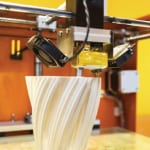 FIGURE 1. The 3-D printing market surpassed $3 billion in 2014, and more growth is expected