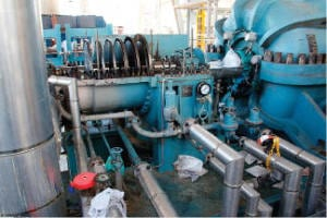 FIGURE 1. Shown here is a steam turbine dismantled for repair. This is the driver of the centrifugal compressor