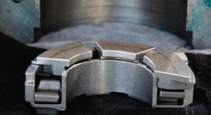 FIGURE 2. Tilting pad thrust bearings are widely used in relatively high-speed rotating machinery. These bearings are vulerable and can be damaged easily; shown here is one that was removed for repair