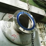FIGURE 1.  This photo shows a reinforced nozzle on a rectangular tank during onsite construction. Note the weep hole located at the bottom of the reinforcement pad