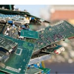 FIGURE 1.  Electronics waste — including discarded circuit boards and mobile phones — can contain many valuable materials