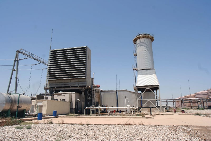 FIGURE 4.  A example of a very large gas turbine installation. The air inlet filter and the exhaust gas stack are also shown.