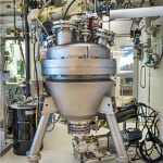FIGURE 1. JBEI has scaled up biomass pretreatment technologies that utilize ionic liquids from the bench scale to the 100-L scale using a reactor located at the Advanced Biofuels Process Demonstration Unit (ABPDU)