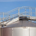 Figure 3.  A metal catwalk on the roof of a storage tank provides some protection for workers, as it is unsafe for personnel to walk directly on a tank's shell