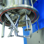 FIGURE 1. This planetary disperser is equipped with two  helical, planetary stirrers, four saw-tooth blades (two on each high-speed shaft), a removable sidewall scraper arm, and a bottom scraper (attached to one of the stirrers)