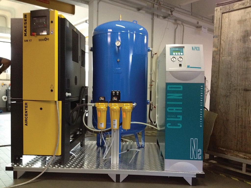 FIGURE 3.  A typical onsite PSA system uses two vessels, both filled with CMS pellets. They operate in an alternating mode, so that at any time, one is in pressurization mode to enable air separation (to allow the nitrogen product stream to be collected), while the other tank is in depressurization mode, to allow the adsorbed oxygen to be released to the atmosphere (Credit: Claind S.r.l.)