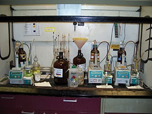 FIGURE 4.  Shown here is an installation that relies on the laboratory hood for spill containment. The hazard analysis that had been carried out here was shortsighted, in that it only focused on the relatively low flowrates presented by the small volume of fluid, rather than on a potential incident that could result in an entire bottle breaking, releasing its contents