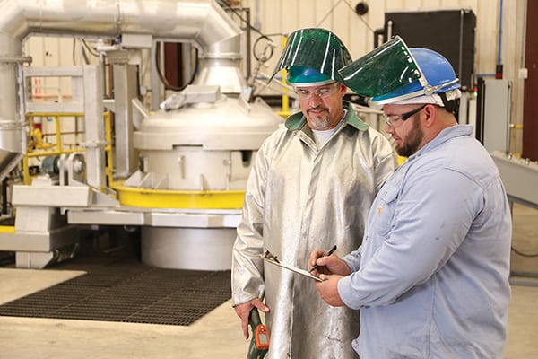 Figure 2.  Hereaus workers discussing the production process at the Wartburg plant Hereaus Precious Metals